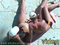 Couple on the beach voyeur1
