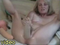 Bored mature lady trying a new big toy